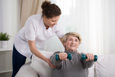 senior woman training with physiotherapist