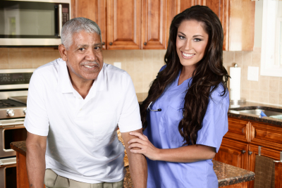 beautiful female caregiver and senior man are smiling